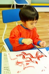 Young learner exploring with a paint brush
