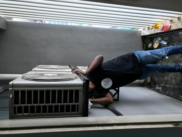 Servicing aircon outdoor unit