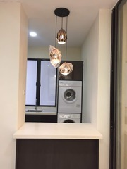 kitchen cabinet and laundry area