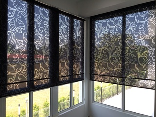 Burned out design roller blind
