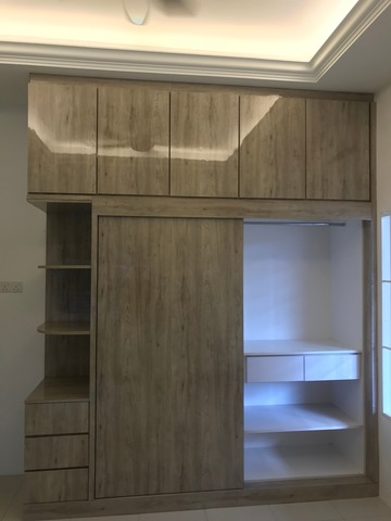 Two-door wardrobe with extra storage space attached on ceiling.