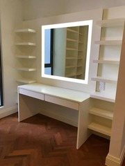 Dressing table attached with display shelves. LED lights were added around the mirror to increase the ambience.