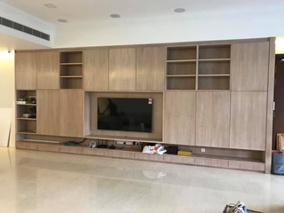 TV Cabinet in the living room - cabinets were added for extra storage.